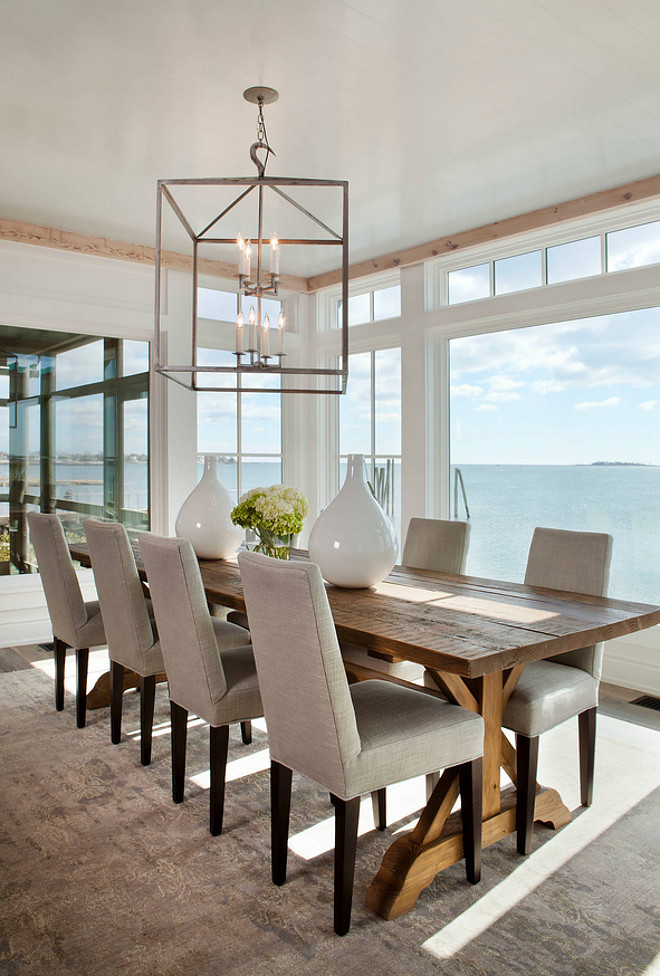 Dining room table and chairs. Farmhouse table in dining room. The table, dining chairs and lighting in this dining room are from Lillian August. #Diningroom #Table #chairs #furniture #lighting Michael Greenberg & Associates.
