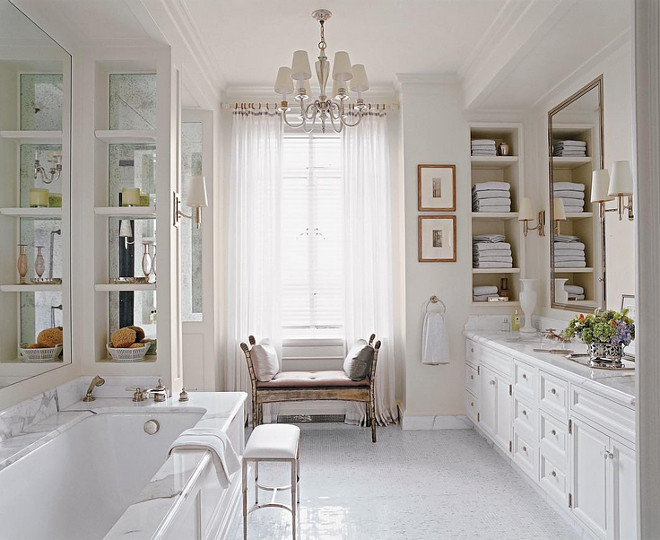 Bathroom. This all-white bathroom has got us wanting to sink into a relaxing bubble bath. Marble surfaces and antique satin vanity benches make this bathroom classic and elegant. Bathroom Shelves. Architectural Digest.