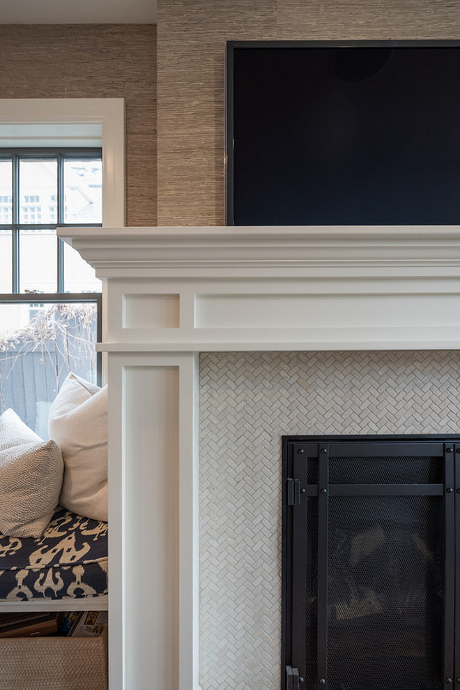 Fireplace tile ideas. Affordable fireplace tile. This herringbone mini tile is an affordable choice for fireplace surround tile. #fireplace #tile #affordabletile #herringbonetile #minitile Northstar Builders, Inc.
