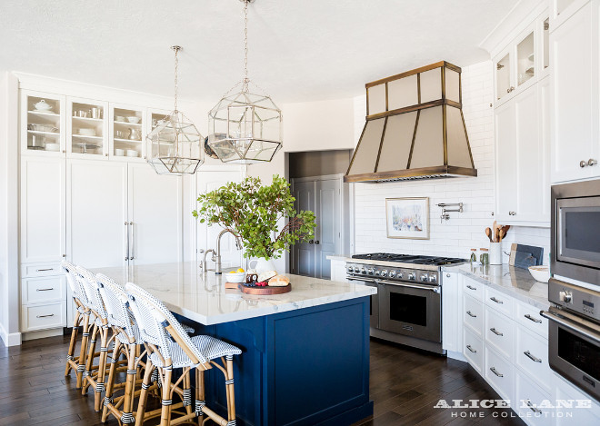 White Kitchen with Navy Blue Island Reno. White Kitchen with Navy Blue Island Reno Ideas. See how to copy this look on the blog post. #WhiteKitchen #NavyBlueIsland #KitchenReno #RenoIdeas Alice Lane Home.