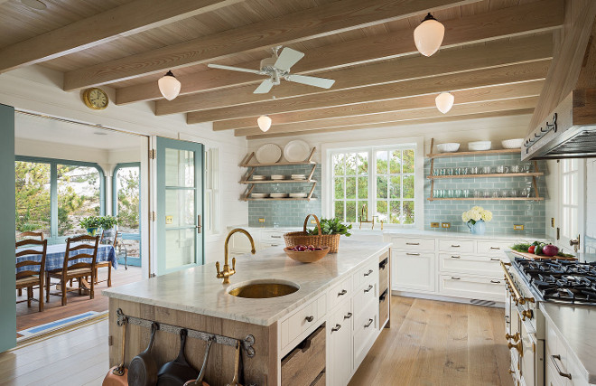 Kitchen. This beach house kitchen is the perfect mix of updated beauty and that classic, beach cottage chic that makes this the kind of place we would want to come back to again and again. #kitchen #beachhousekitchen #kitchens #kitchenideas Dearborn Builders. Interiors by Tory Haynes.
