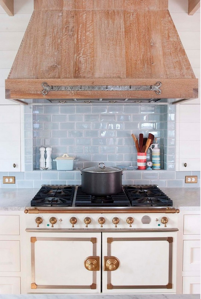 Reclaimed wood hood. Kitchen with reclaimed wood hood. Kitchen hood is made of cerused oak wood. #cerusedoak #kitchenhood #cerusedoakhood #reclaimedwoodhood #reclaimedwoodkitchen #kitchenreclaimedwood #kitchenhood Dearborn Builders. Interiors by Tory Haynes.