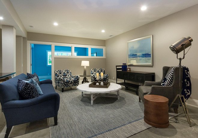 Basement Living room. Beautiful Basement Living room with blue and white decor and industrial accents. Basement Living room #BasementLivingroom #Basement #Livingroom