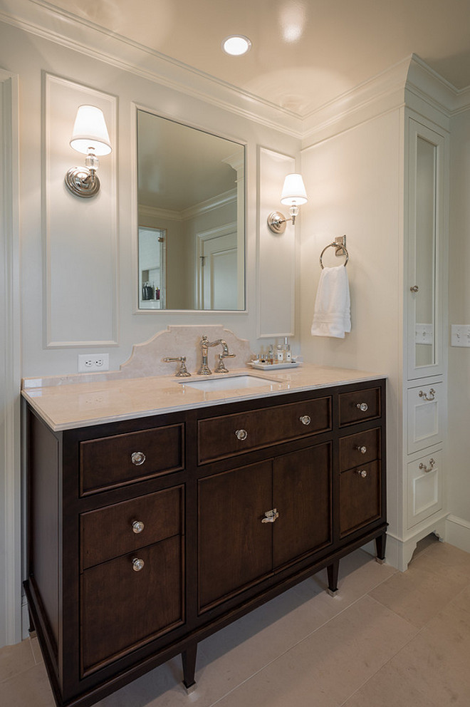 Bathroom features a combination of dark walnut cabinets and painted white cabinets. Northstar Builders, Inc.