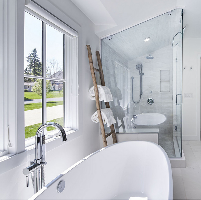 Bathroom ladder. Bathroom towels placed on ladder. A wooden ladder brings texture to this white bathroom. #bathrom #ladder #towels Martha O'Hara Interiors