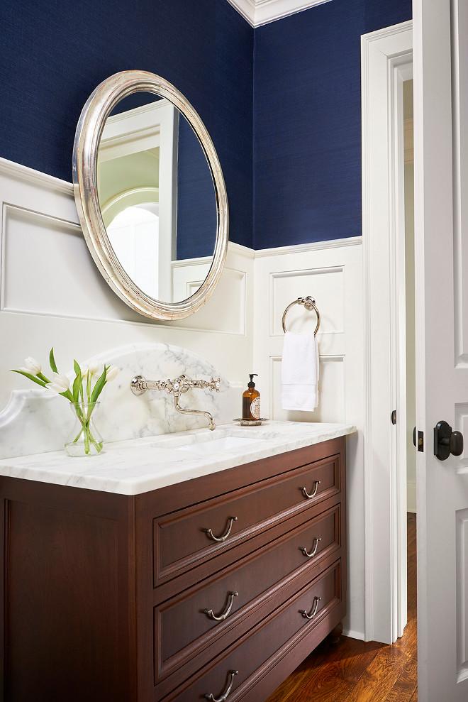 Bathroom wainscoting walls with wallpaper above. L. Kae Interiors