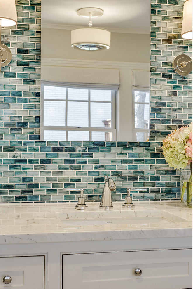 Bathroom wall accent. The wall tile is from Complete Tile Collection - Zumi Glass Tile. Bathroom with marble countertop and wall accent tile. Wall accent tile in bathroom. #Bathroom #AccentTilewall #Accentwall #Tilewall #tile #wall #tiling Redo