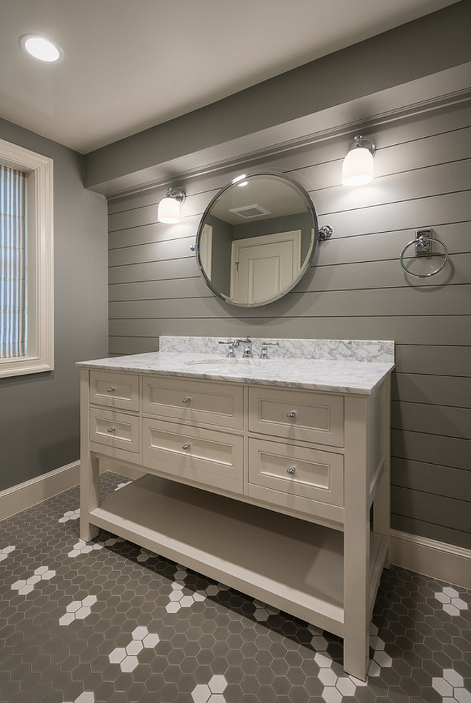 Bathroom with shiplap accent wall painted in dark gray paint color. Basement Bathroom with shiplap accent wall painted in dark gray paint color #Bathroom #shiplapaccentwall Northstar Builders, Inc.