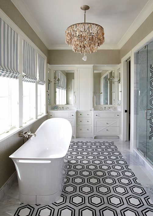 Hex Floor Tiles. The master bathroom features white, black and gray hexagonal tiled floor. The hex floors are New Ravenna Pembroke Tiles. #Hex #floortiles #hextiles #NewRavenna #Pembroke #Tiles