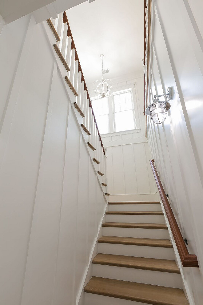 "Batten and Board Staircase. Batten and Board Staircase Wall. The staircase features batten and board panels painted in Sherwin Williams Extra White. Trim Dimensions: 1x2 flat work every 18"". Batten and Board Staircase Wall Dimensions. #BattenandBoard #Staircase #BattenandBoardStaircase #StaircaseWall #Dimensions"