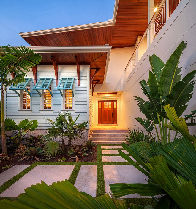 Beach house with turquoise window shutters. Turquoise window shutters. Turquoise window shutters ideas. #Turquoise #windowshutters  BORDEN Landscape Design