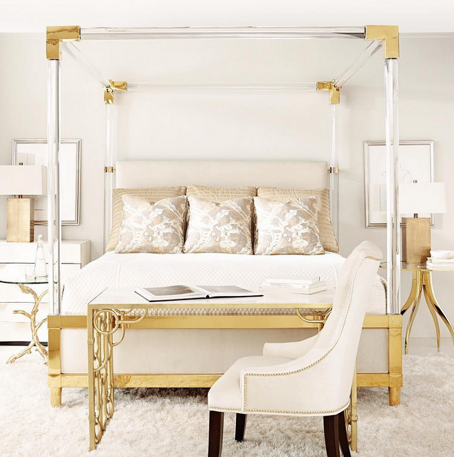 Bedroom with brass accents. Bedroom with brass and lucite canopy bed. Phebe Regency Brass Acrylic Ivory Upholstered Canopy King Bed #Bedrom #brass #lucitebed