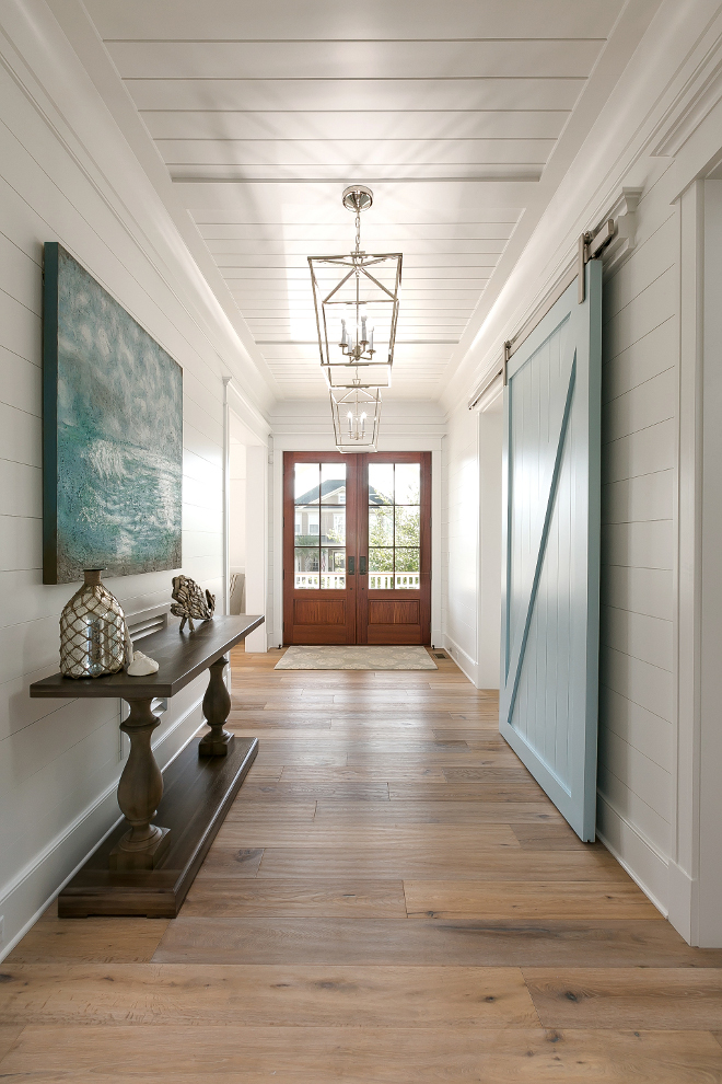 Benjamin Moore Yarmouth Blue. Shiplap foyer walls and blue barn door painted in Benjamin Moore Yarmouth Blue. This gorgeous foyer feature shiplap walls, tongue and groove paneling ceiling and blue barn door painted in Benjamin Moore Yarmouth Blue. Blue barn door paint color is Benjamin Moore Yarmouth Blue #Foyer #shiplap #Bluebarndoor #barndoor #BenjaminMooreYarmouthBlue