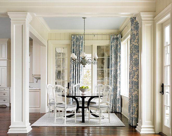 Breakfast room. In the breakfast room, the Pottery Barn chairs were repurposed from previous home. The designer painted them in Alabaster by Sherwin Williams in semi gloss to refresh them. Round breakfast table was from Holland and Company. Breakfast Room Drapery Fabric: Schumacher. #BreakfastRoom T.S. Adams Studio. Interiors by Mary McWilliams from Mary Mac & Co.