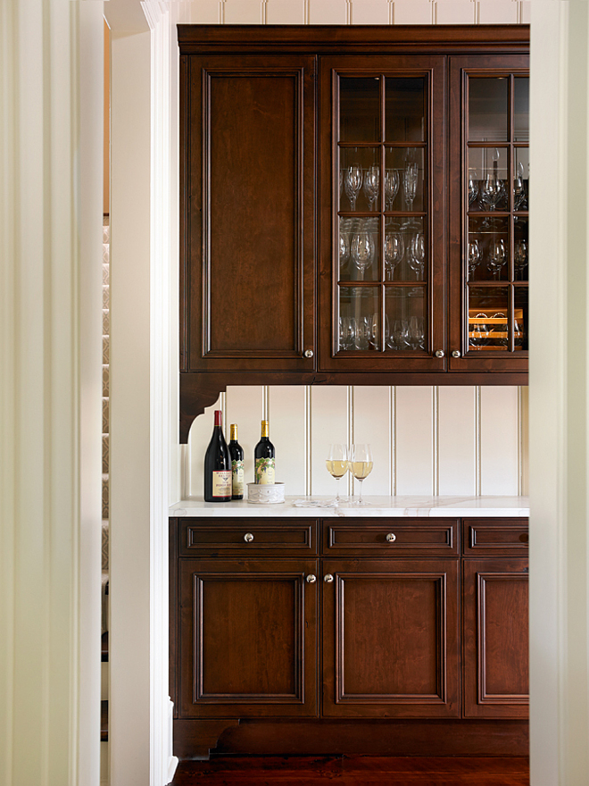 Butler's Pantry. Butler's Pantry with dark stained cabinet and white marble countertop. Marble countertop is Calcutta Danby. Wall paint color is Benjamin Moore OC-8 Elephant Tusk. #ButlersPantry #darkcabinet T.S. Adams Studio. Interiors by Mary McWilliams from Mary Mac & Co.
