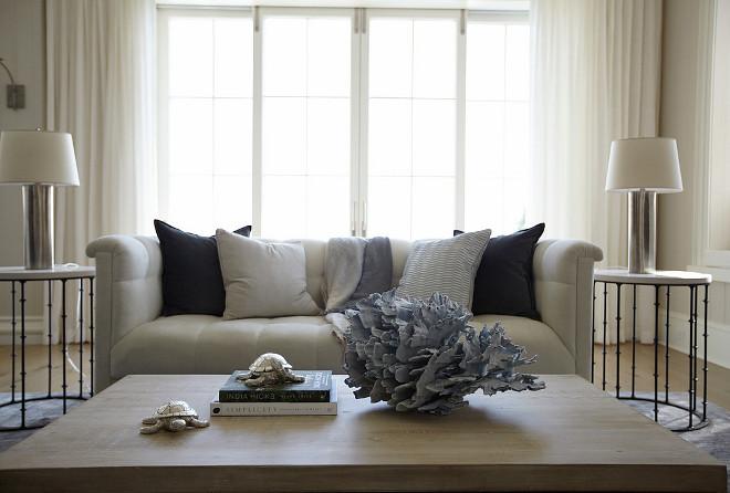 Coastal decor on coffee table. Elegant coastal decor on coffee table. #coastaldecor #coffeetable #homeideas #homedecor TS Adams Studio Architects. Laura Allyson Interiors.