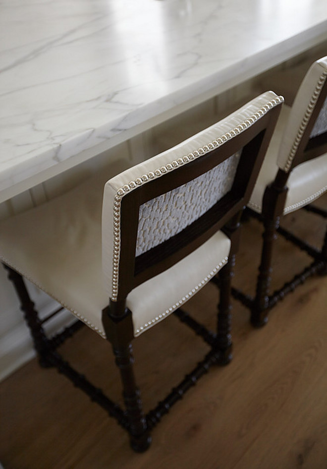Counter stool fabric combination ideas. The designer explains that she used outdoor fabric and leather on most of the upholstery because she wanted the interior to not only feel attractive but also to be very durable.