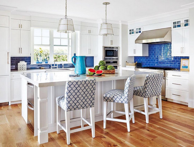 Crisp white kitchen with blue tile backsplash. Beautiful Crisp white kitchen with blue tile backsplash. #Crispwhitekitchen #bluetile #backsplash Jackie Armour Interiors