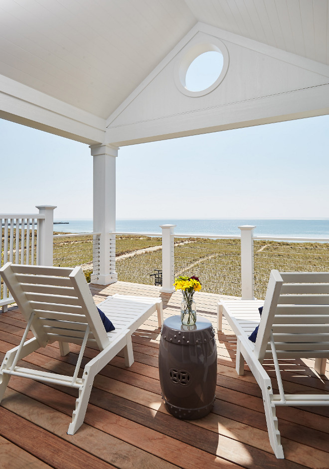 Deck ideas. Deck with cable railing, vaulted ceiling painted in Benjamin Moore PM-1 Super White exterior paint and Ipe deck wood. Mike Schaap Builders