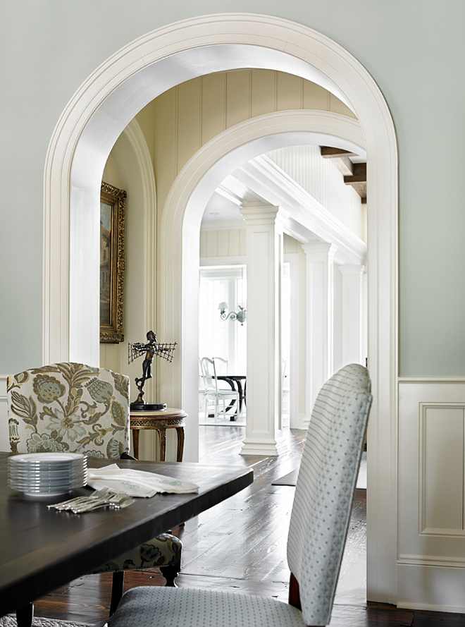 Dining room millwork. Dining room features wall wainscoting, archway with wall paneling and large trims and moldings. Dining room millwork #Diningroom #millwork #wallpaneling #trim #molding #archway #arch T.S. Adams Studio. Interiors by Mary McWilliams from Mary Mac & Co.
