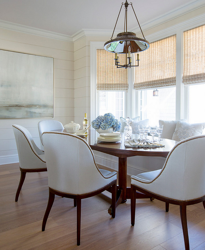 Elegant Breakfast nook with banquette and beautiful white dining chairs. #Breakfastnook #banquette #whitediningchairs Phoebe Howard. Jessie Preza Photography.