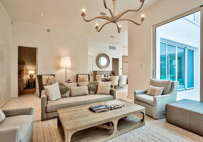 Family Room. Family Room Furniture, rug, lighting. I love the comfortable, casual furniture featured in the family room. Isn't this space inviting? #familyroom #rug #furniture #lighting Scenic Sotheby's Realty. Interiors by Jan Ware Designs.