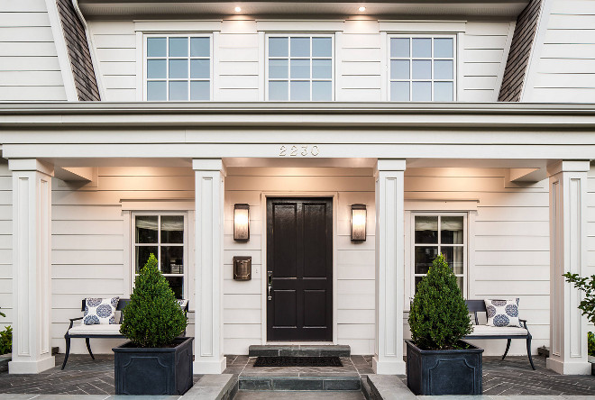 Front porch planters, columns, classic front door, slate herringbone porch tile, porch benches. #porch #frontporch #planters #porchtile #herringbonetile