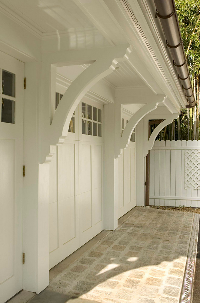 Garage Brackets. Garage doors are made by Artisan Doors, the Lexington Line and the Spanish cedar garage brackets, corbels and trims were custom designed by Lasley Brahaney Architecture + Construction