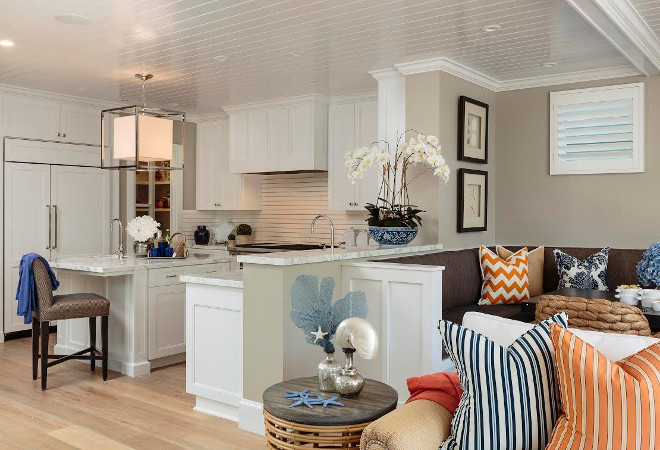 Kitchen and breakfast nook with beadboard ceiling. White beadboard ceiling in kitchen and breakfast nook with banquette. Designed by Barclay Butera.