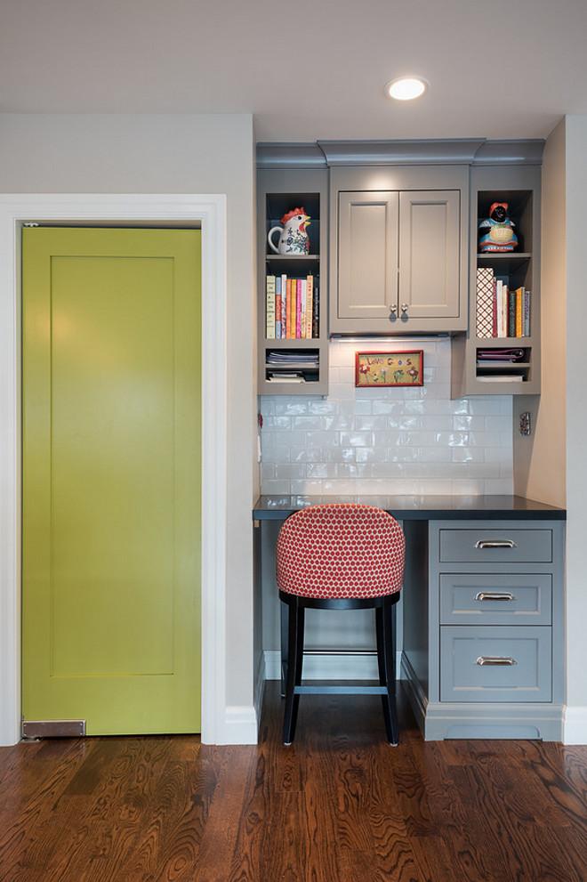 Kitchen desk by pantry. Kitchen desk by pantry with door painted in a similar color Benjamin Moore Chic Lime. #kitchen #desk #kitchendesk #pantrydoor #pantry #BenjaminMooreChicLime Northstar Builders, Inc.