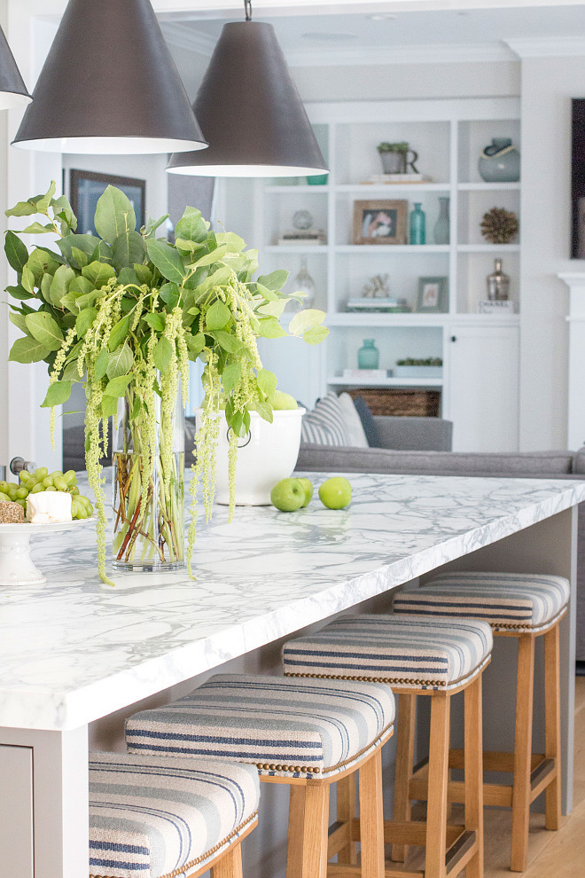 Kitchen island with marble countertop and striped counterstools. Beautiful Kitchen island with marble countertop and striped counterstools. #Kitchenisland #marblecountertop #stripedcounterstools Blackband Design