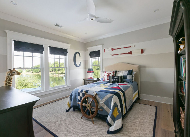 Large wall stripes. Bedroom with large stripes painted on walls. Large wall stripes paint color is Sherwin Williams Anew Gray and Sherwin Williams Creamy striped. The Guest House Studio