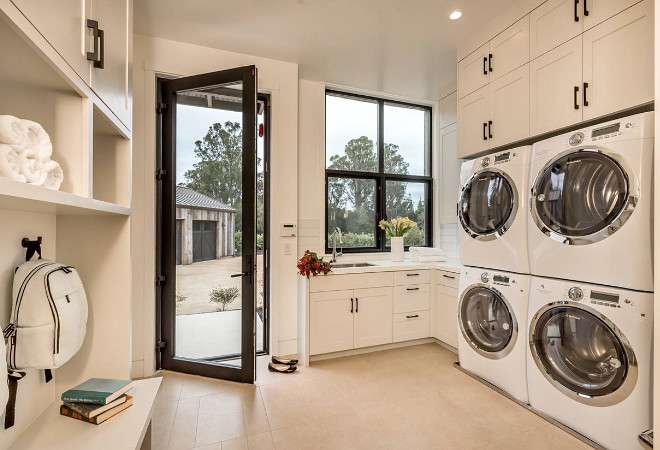 Laundry room with double washer machine and double dryer machine. Two washers and two dryer machines in laundry room. #Laundryroom #doublemachines #twodryers #twowashers Clarum Homes