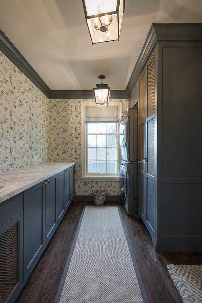 Laundry room with grey cabinets and trim. Laundry room with grey cabinets and dark grey trim. #Laundryroom #greycabinets Northstar Builders, Inc.