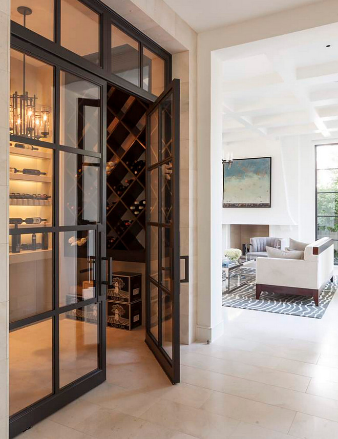 Main floor wine cellar with black stainless steel. Main floor wine cellar. #winecellar #mainfloorwinecellar Stocker Hoesterey Montenegro.