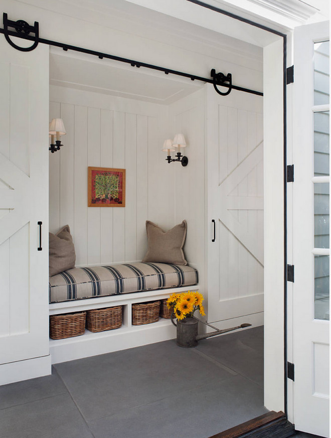 Mudroom with sliding barn doors. Farmhouse Mudroom Nook with slinding barn doors. Farmhouse Mudroom Nook with slinding barn doors - barn door hardware. #FarmhouseMudroom #mudroom #Nook #slindingbarndoors #barndoor Lori Henle Interiors