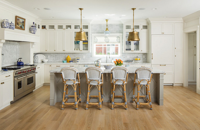 Off white kitchen with gray island and white oak hardwood floors. Beautiful Off white kitchen with gray island and white oak hardwood floors. #Offwhitekitchen #grayisland #whiteoak #hardwoodfloors