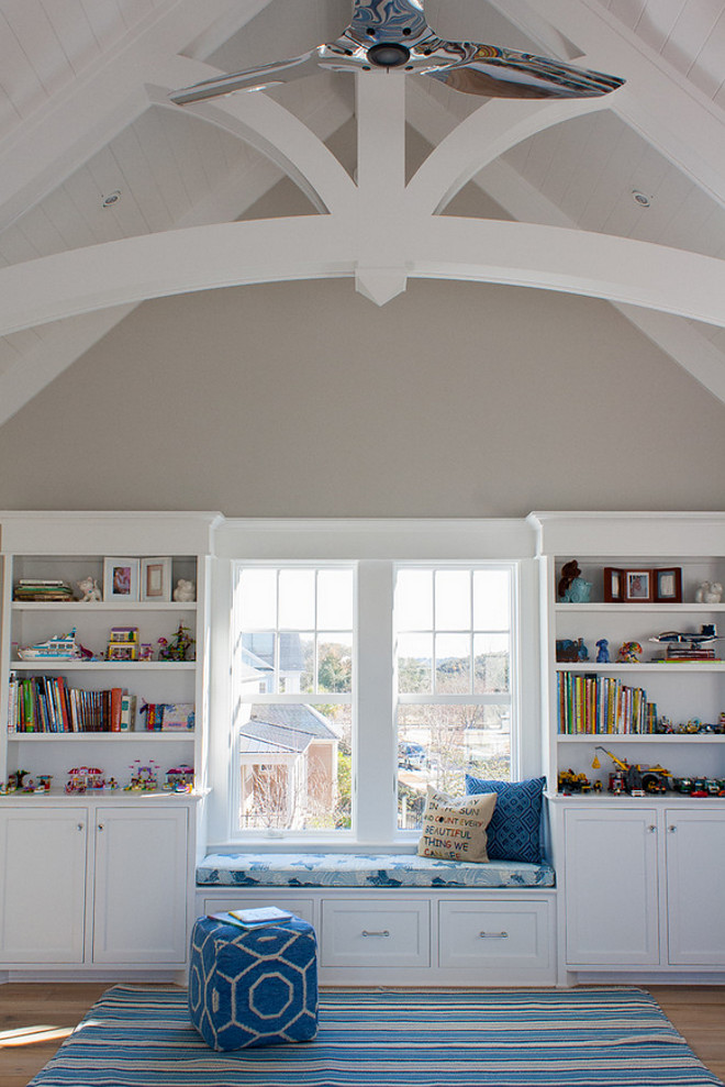 Playroom with vaulted ceiling arched beams. Neutral playroom with vaulted ceiling arched beams and window seat. #Neutralplayroom #Playroom #vaultedceiling #archedbeams #windowseat