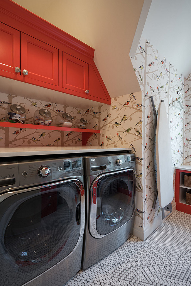 Red cabinet paint color. Laundry room with red cabinets. Laundry room with red cabinets and Schumacher paper A-Twitter wallpaper. #redcabinet #paintcoor #laundryroom Northstar Builders, Inc.
