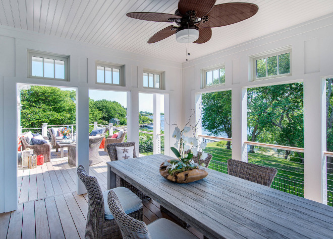 Four Seasons Sunroom. Screened in porch with outdoor dining area. Beadboard ceiling on screened in porch and stainless steel cable railing #screenedinporch #porch #screenedin #FourSeasons #Sunroom #Beadboardceiling Caldwell & Johnson Custom Builders & Remodelers