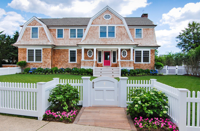 Shingle home with white picket fence. If this doesn't scream curb appeal I am not sure what else does. Dearborn Builders.