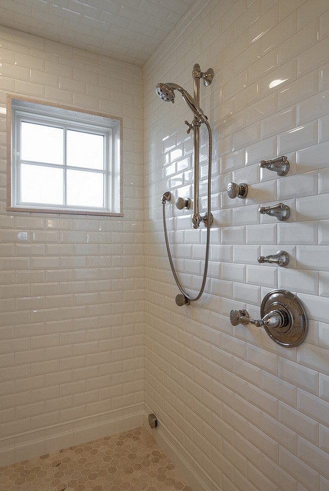 Shower features floor to ceiling beveled subway tiles and octagon marble tiles on floors. Marble slab surrounds shower window.. Marble slab surrounds shower window. Northstar Builders, Inc.