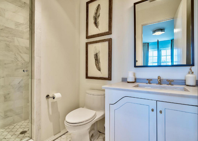 Small Guest Bathroom. This neutral small bathroom has a calm and serene feel... notice the cabinetry design. #smallbathroom #neutralbathroom Interiors by Jan Ware Designs.