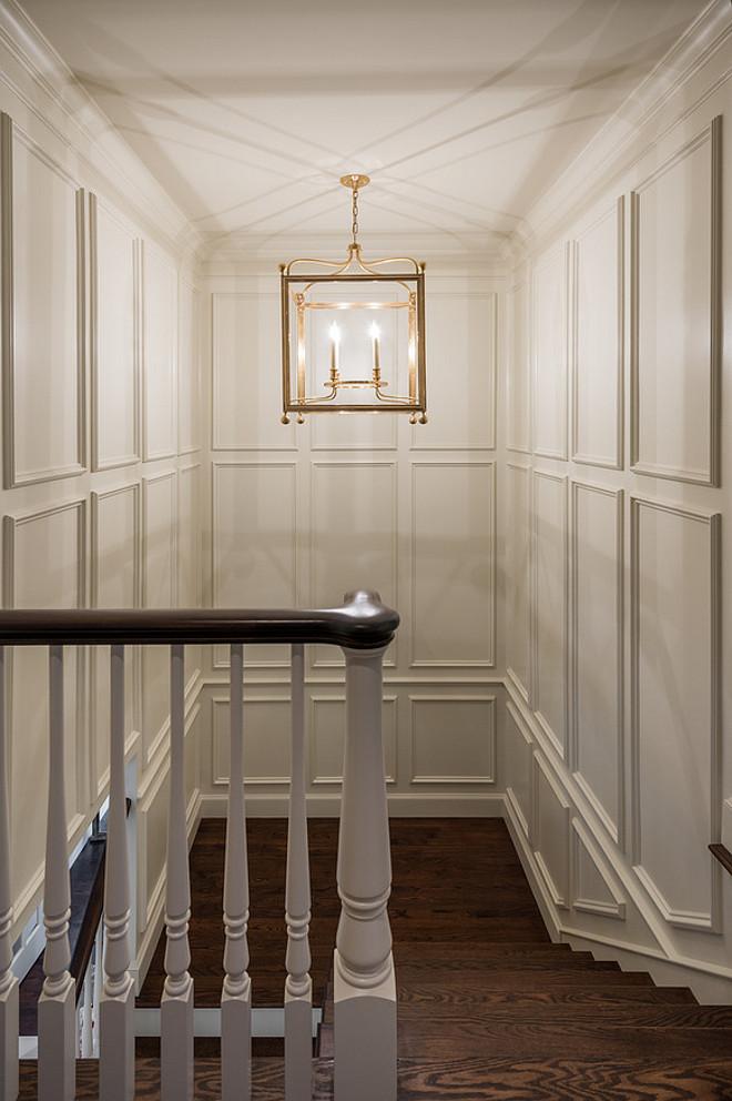 Stairway lighting. Stairway featuring paneled walls and lantern pendant lighting. #stairway #lighting #paneledwalls Northstar Builders, Inc.