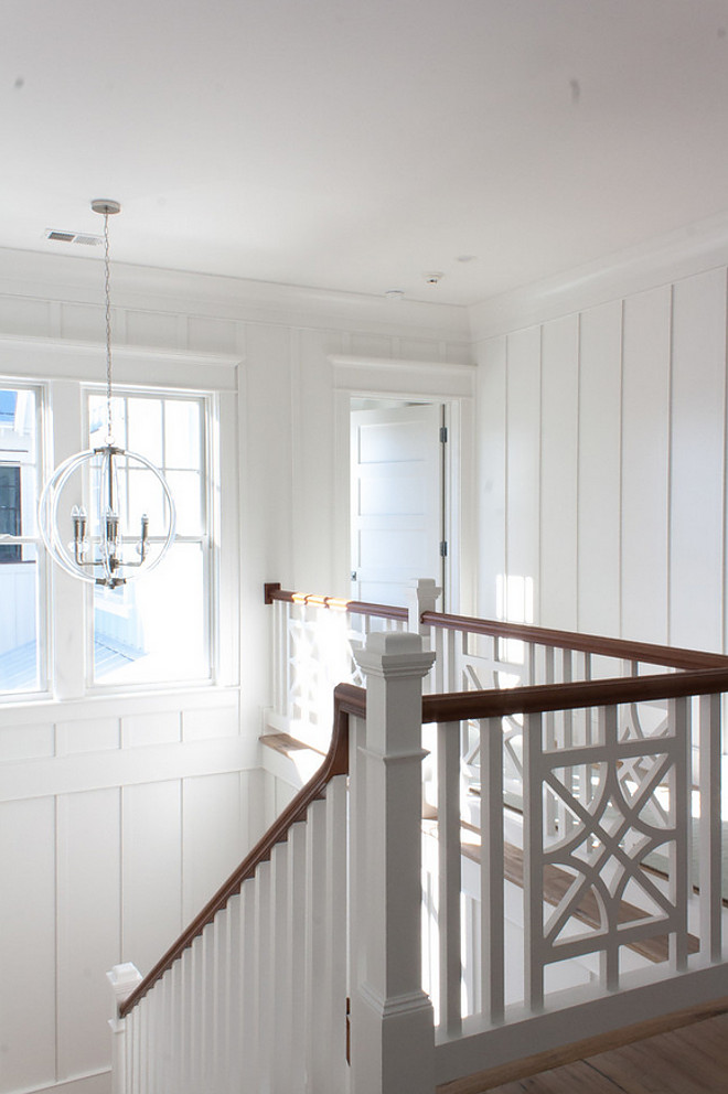 "Stairwell Millwork. Upper stairwell millwork. The staircase features batten and board panels painted in Sherwin Williams Extra White. Staircase railing is custom. Trim Dimensions: 1x2 flat work every 18"". Pendant: Lucite Silver Pendant. Stairwell Millwork. Upper stairwell millwork. #LuciteSilverPendant #Stairwell #Millwork #Upperstairwell #stairwellmillwork The Guest House Studio"