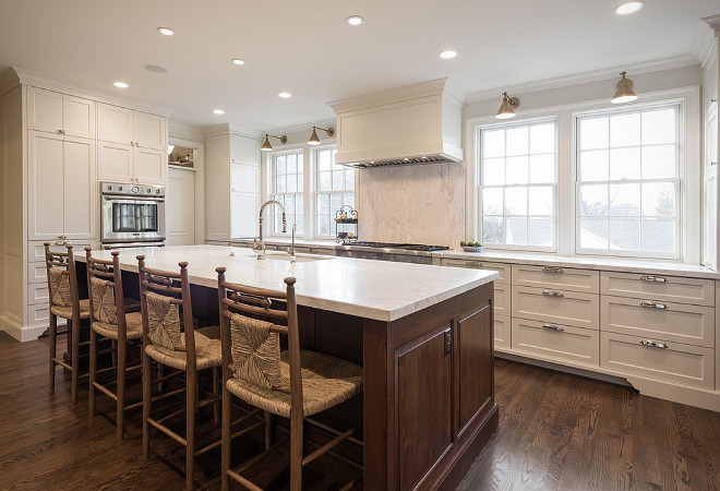 White Dove by Benjamin Moore kitchen cabinets with walnut stained kitchen island. Northstar Builders, Inc.