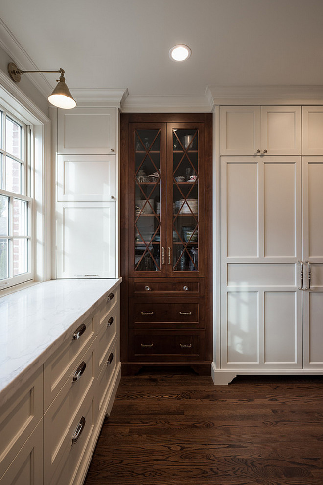 White Kitchen with china cabinet stained in walnut. White kitchen with dark walnut china cabinet. #Whitekitchen #darkwalnut #chinacabinet Northstar Builders, Inc.
