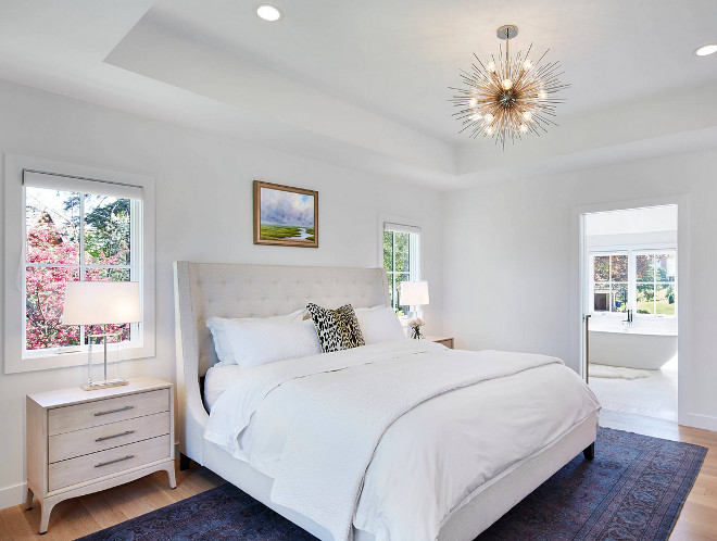 White bedroom paint color. This Scandinavian-inspired bedroom has a calming feel thanks to its crisp white walls and clean-lined decor. Wall paint color is, once again, Benjamin Moore Super White OC-152, in flat finish. Notice the tray ceiling. Martha O'Hara Interiors
