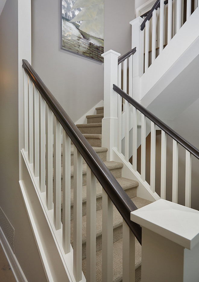 White staircase trim paint color. Benjamin Moore White Dove white staircase paint color. Staircase painted in Benjamin Moore White Dove. #BenjaminMooreWhiteDove #staircase #paintcolor #trim
