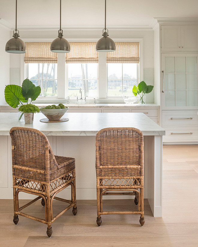 Wicker counterstools. Neutral kitchen with antique wicher counter stools. Wicker kitchen stools and bamboo shades bring some natural texture to this neutral kitchen #neutralkitchen #whickerstools #whickercounterstools #whicker #counterstools Phoebe Howard. Jessie Preza Photography.